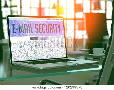 E-Mail Security on Laptop in Modern Workplace Background.