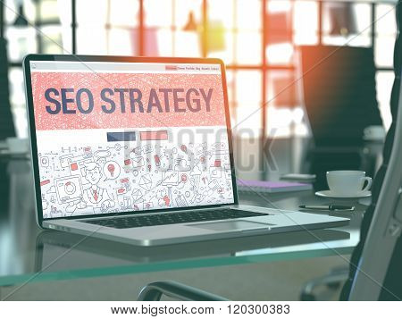 SEO Strategy on Laptop in Modern Workplace Background.