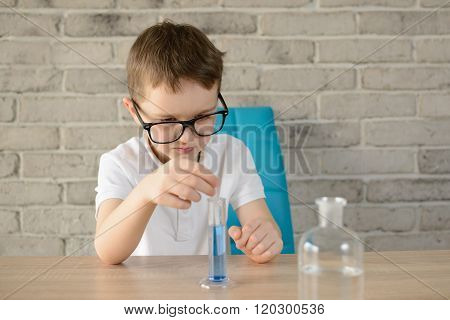 Little Boy Make An Indoor Chemical Test With Water
