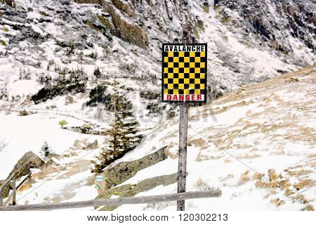 Yellow And Black Avalanche Risk Warning Sign