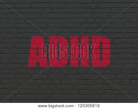 Medicine concept: ADHD on wall background