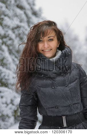 Young woman in a winter forest