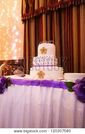 Beautiful Multi-tiered Wedding Cake With Purple Tones
