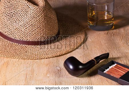 Siesta - Pipe, Straw Hat And Scotch Whiskey On A Wooden Desk