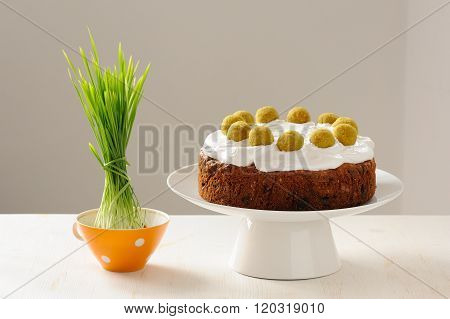 Simnel, English Easter Cake With Royal Icing Decorated With Eleven Balls And Fresh Sprouted Grass On