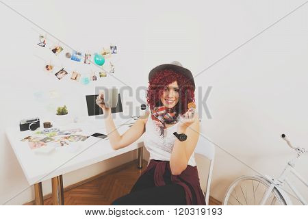 Modern female photographer relaxing in her home office