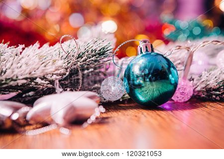 Spruce Branches In The Snow, And Blue Balls Wooden Background