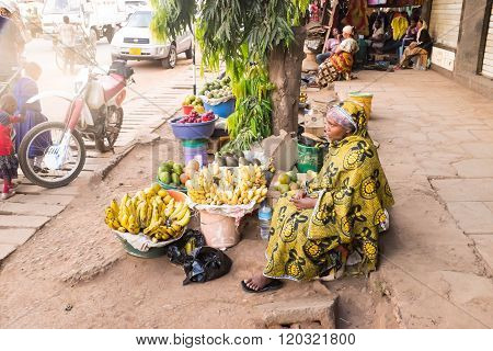 Moshi, Tanzania  - January 15:  An Unidentified African Young Woman Sells Fuits On The Street Market