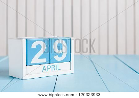 April 29th. Image of april 29 wooden color calendar on white background.  Spring day, empty space fo