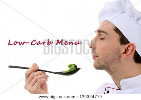 Chef tasting broccoli isolated on white and Low-Carb menu text