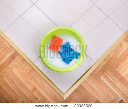 Washbasin With Cleaning Tools On The Floor