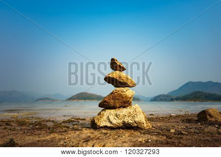 Stones Balance And Blue Sky Background