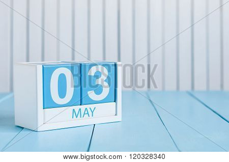 May 3rd. Image of may 3 wooden color calendar on white background.  Spring day, empty space for text
