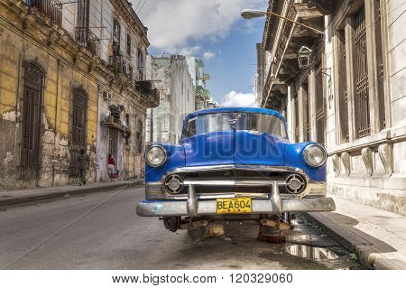 Old american car without wheels in Cuba