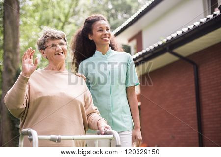 Strolling With Elder Woman
