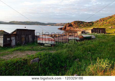 Old fishing boats on the shore of Teriberka Murmansk region