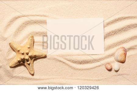 Starfish, Scallop Seashell, Stones With White Card On Beach Sand