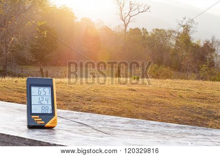 Digital Display Thermometer With Grass And Sunlight