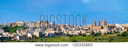 Panorama view of Mgarr city with green field. Gozo, Malta