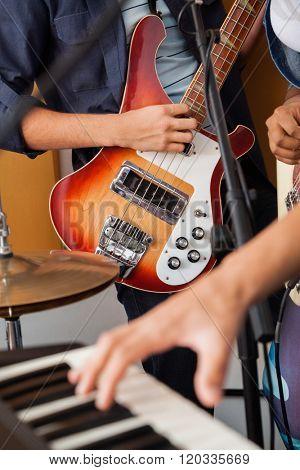 Band Member Playing Guitar In Recording Studio