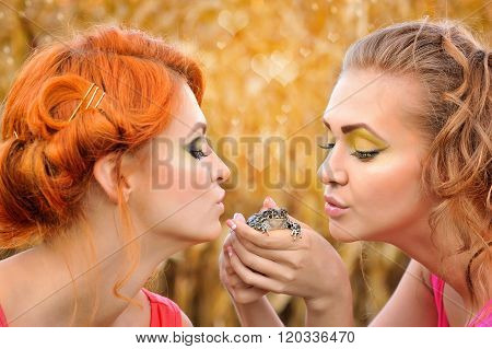Beautiful Young Girls Holding A Cute Frog