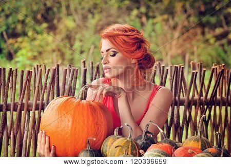 Beautiful Young Woman With Pumpkin. Autumn. Harvest Season.