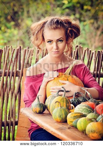 Beautiful Young Woman With Pumpkin. Autumn. Harvest Season