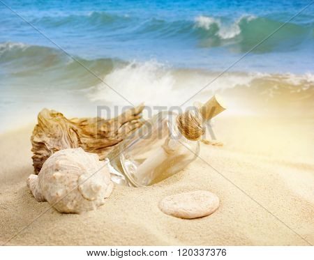 Summer Sandy Beach Concept With Letter In Bottle
