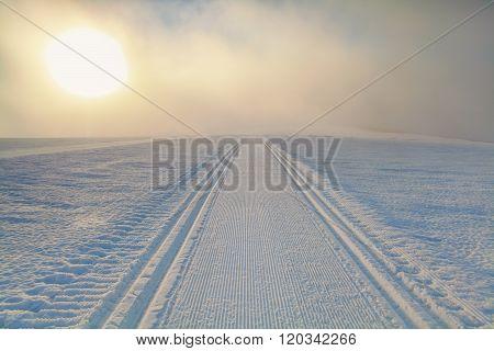 Ski Path On Snow At Sunrise