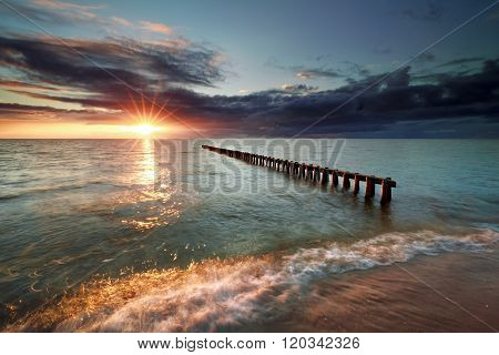 Sunset Over Breakwater In Ijsselmeer Lake