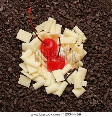 Maraschino cherry on a white and dark chocolate. Cherry on the cake.