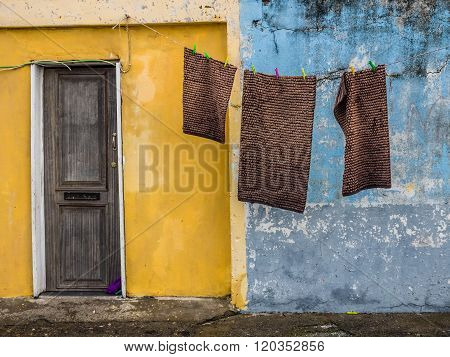 Laundry hanging in front of the people home in poor neighbourhood in Ponta Delgada, Azores, Portugal