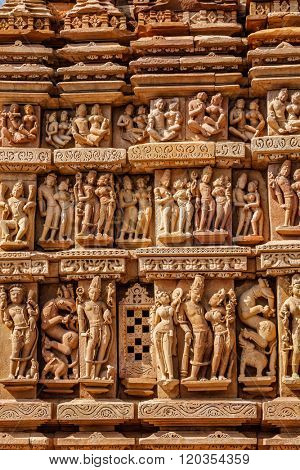 Stone carving bas relief sculptures on Vaman Temple, famous indian tourist site Khajuraho, Madhya Pradesh, India