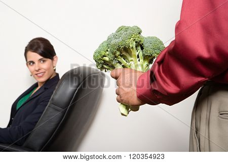 Man holding a bunch of broccoli