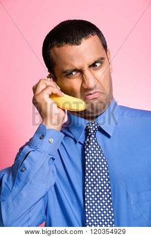 Man using a banana as a telephone