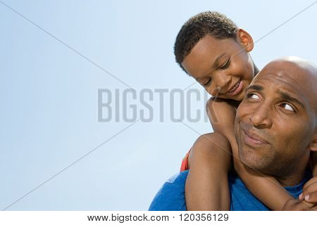 Son on fathers shoulders