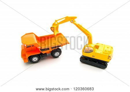 Truck And Yellow Backhoe