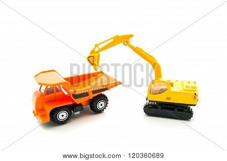 Orange Truck And Yellow Backhoe