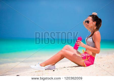 Active fit young woman in her sportswear during beach vacation