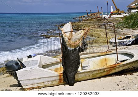 Worn-out boat with a homemade sun shelter