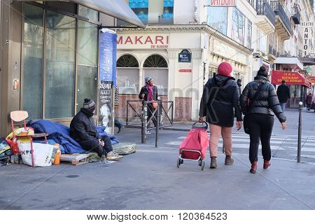 Paris, France - February 11, 2016: homeless man in a center of Paris, France.