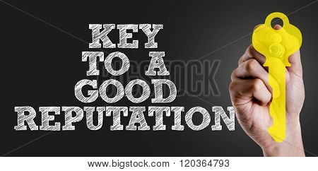 Hand writing the text: Key to a Good Reputation
