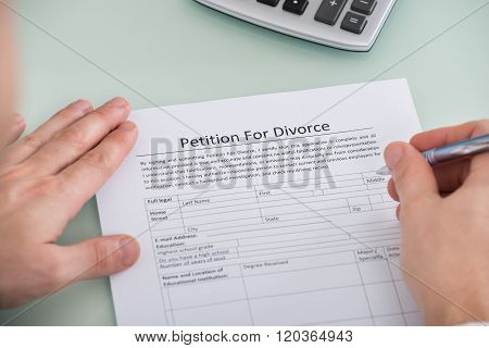 Person Hand Over Petition For Divorce Form