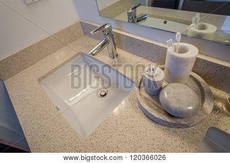 White bathroom sink. Elegant polished and clean sink stone decorations. Interior design.