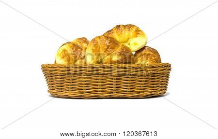 Golden brown croissant in rattan basket isolated on white background