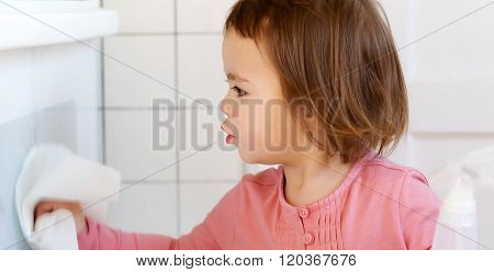 Toddler Girl Cleaning The Kitchen