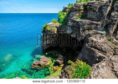 Amazing view of entrance to grotto from the lake side at Bruce peninsula Cyprus lake, Ontario
