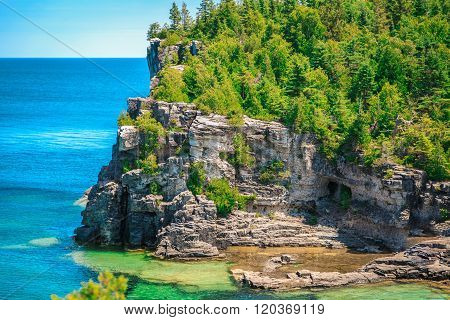 Amazing natural rocky beach landscape view and tranquil azure water at beautiful Bruce peninsula