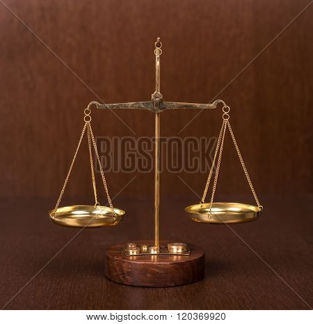 Law scales on table. Symbol of justice