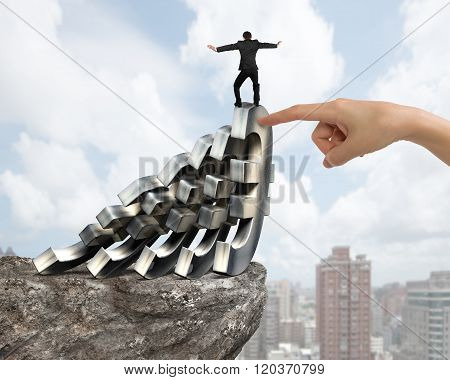 Businessman Balancing Falling Euro Symbols With Woman Hand Helping